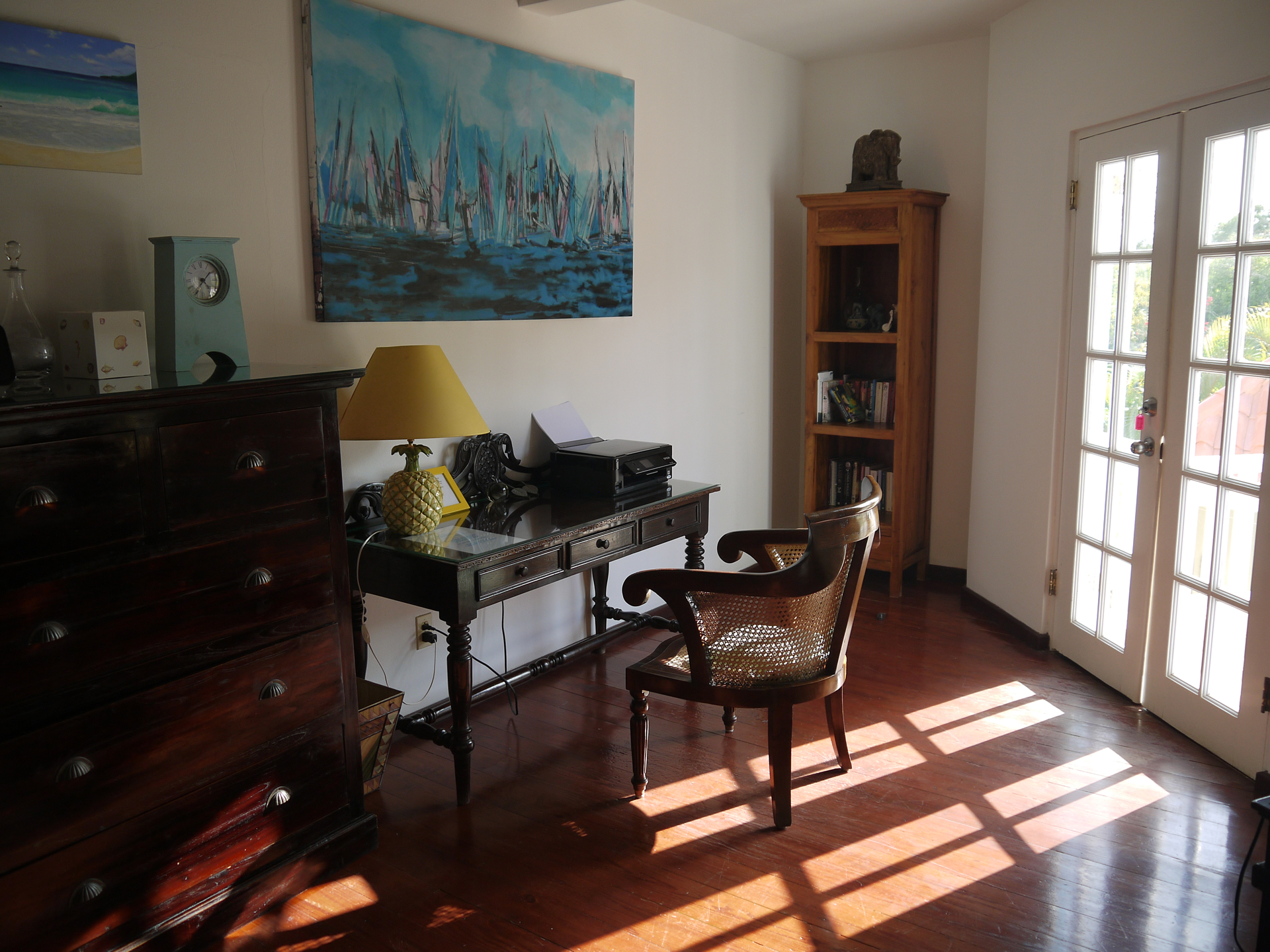 Wooden floors and tastefully furnished with antiques