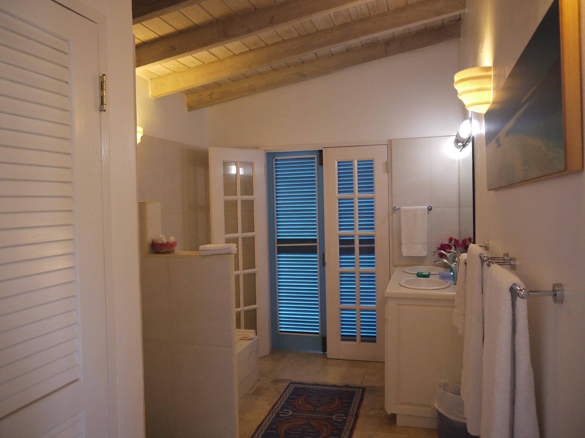 En-suite with bath, shower, double wash basins and separate toilet